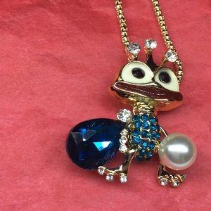 Gold tone cartoon style jeweled frog w/crown